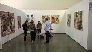 Helen Teede (center) in discussion with visitors to the First Floor Gallery Zimbabwe Booth